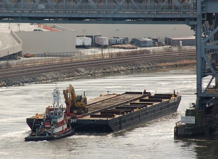 Barge of Death passes under the Broadway Bridge