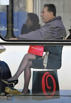 A man sits on bus with an advert for a clothes store in Ljubljana March 2, 2009