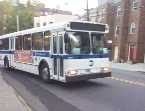 "NYCT Bus Orion V 6257 (Bx20). Note that the destination sign is broken and two ""paper 20's"" can be seen behind the windshield."