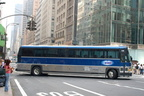 New York Airport Service MCI 102A2 148 @ 42 St & 5 Av. Photo taken by Brian Weinberg, 7/28/2006.
