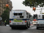 NYCT Orion V 6033 II and RTS 8857 @ Kingsbridge Ave and 231 St (Bx7 and Bx20). Note that the rear of the bus is painted white in