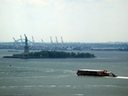 barge passing the Statue of Liberty