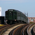 R-1 100 @ 30 Av (N/W). Museum train is in-service. Photo taken by Brian Weinberg, 10/28/2004.