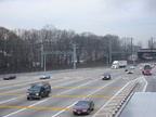 Northbound lanes @ New York State Thruway's New Rochelle Toll Barrier. The Northeast Corridor rail line is in the background.