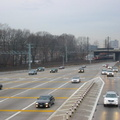 Northbound lanes @ New York State Thruway's New Rochelle Toll Barrier. The Northeast Corridor rail line is in the background, wi