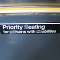 Sign reads: Priority eating for sons with abilities. On an R-42.