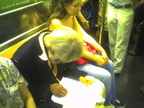 This guy that does pencil drawings of people on the subway (on a 3 train). Photo taken by Brian Weinberg, 9/14/2005.