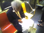 This guy that does pencil drawings of people on the subway (on a 1 train). Photo taken by Brian Weinberg, 9/14/2005.