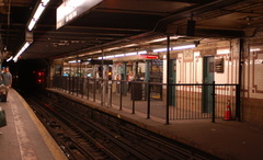 96 Street (1/2/3) - the former uptown local platform - now a fare control area. Photo taken by Brian Weinberg, 7/23/2006.