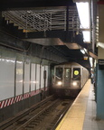 R-40 4285 @ Times Square - 42 St (W) - southbound platform, with the new staircase overhead.