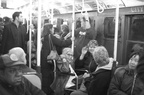 R-1 381 @ Lower East Side - 2 Av (V). Interior. Note the woman in a wheelchair on a non-ADA train. Photo taken by Brian Weinberg