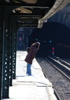 Dyckman St (1). Woman looking into tunnel for oncoming train. Photo taken by Brian Weinberg, 3/2/2008.