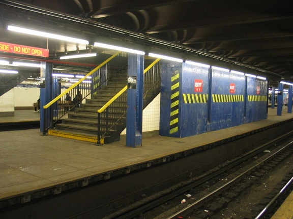Temporary wooden shed built on to the back of a staircase on the center platform @ 59 St-Columbus Circle. Photo taken by Brian W