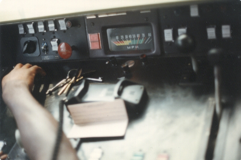PATCO train operator's dash during a fan trip. Note that the speedometer shows the current speed as 60+ MPH. Photo taken by John
