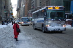 MTA Bus MCI Cruiser 3117 @ 42 St & 5th Ave (BxM10). Photo taken by Brian Weinberg, 2/13/2006.